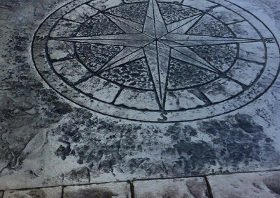 Compass Rose Stamp In Patio
