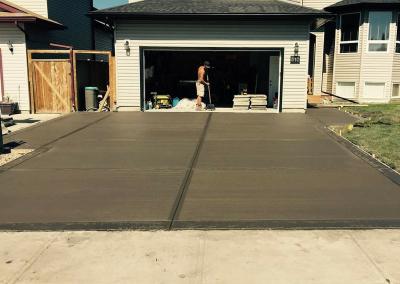 Dark Colored Concrete Driveway Cold Lake